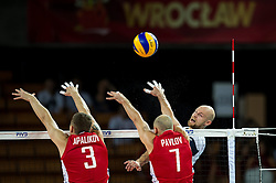 10.09.2014, Century Hall st. Wystawowa 1, Breslau, POL, FIVB WM, Finnland vs Russland, im Bild Nikolay Apalikov russia #3 Nikolay Pavlov russia #7 Antti Siltala finland #5 // during the FIVB Volleyball Men's World Championships Pool A Match beween Finland and Russia at the Century Hall st. Wystawowa 1 in Breslau, Poland on 2014/09/10. EXPA Pictures © 2014, PhotoCredit: EXPA/ Newspix/ Sebastian Borowski<br /> <br /> *****ATTENTION - for AUT, SLO, CRO, SRB, BIH, MAZ, TUR, SUI, SWE only*****