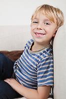 Portrait of cute boy relaxing on sofa