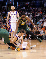Mar. 14, 2012; Phoenix, AZ, USA; Phoenix Suns guard Steve Nash (13) dives for the loose ball with the Utah Jazz center Al Jefferson (25) during the first half at the US Airways Center. Mandatory Credit: Jennifer Stewart-US PRESSWIRE..