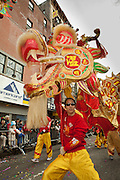 Dragon dancers with a red and gilt dragon.