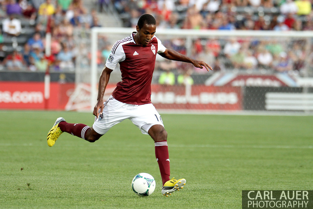 July 7th, 2013 - Colorado Rapids midfielder Atiba Harris (16) dumps the ball in front of the goal in the first half of action in the Major League Soccer match between D.C. United and the Colorado Rapids at Dick's Sporting Goods Park in Commerce City, CO