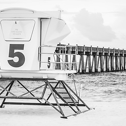 Pensacola Beach Gulf Pier and lifeguard tower five black and white panorama photo. Pensacola Beach is on Santa Rosa Island in the Emerald Coast area of the Southeastern United States of America. Panoramic photo ratio is 1:3. Copyright ⓒ 2018 Paul Velgos with All Rights Reserved.
