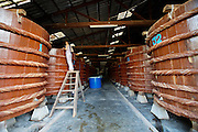 Phu Quoc Island. Duong Dong. Fermentation tanks at a fish sauce (Nuoc Mam) factory.
