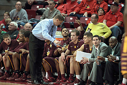 11 January 2014:  Porter Moser uses a white board to explain a situation to his players during an NCAA  mens basketball game between the Ramblers of Loyola University and the Illinois State Redbirds  in Redbird Arena, Normal IL.  Redbirds win 59-50