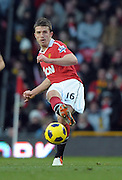 Michael Carrick (Man Utd)  passes the ball during the Barclays Premier League match between Manchester United and Blackburn Rovers at Old Trafford on November 27, 2010 in Manchester, England.