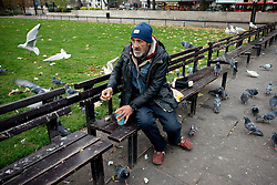 "Romanian beggar opens a can at Marble Arch. Tens of thousands of people from Romania are expected to try to come to Britain once controls are lifted in January. Under ""transitional"" rules introduced when Romania and Bulgaria joined the EU in 2007, migrants from these two countries can only work in the UK in seasonal jobs. These restrictions end on January 1, 2014, and all Romanians and Bulgarians will then have the same rights to work in the UK as British citizens. Marble Arch, London, United Kingdom, Sunday, 1st December 2013. Picture by Peter Kollanyi / i-Images<br />