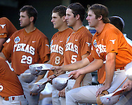 Texas Longhorns (L-R) Thomas Incaviglia, David Maroul and Jordon Street get the rally caps going in the fourth inning against Baylor.  Texas defeated Baylor in the first round of the College World Series 5-1 at Rosenblatt Stadium in Omaha, Nebraska on June 18, 2005.