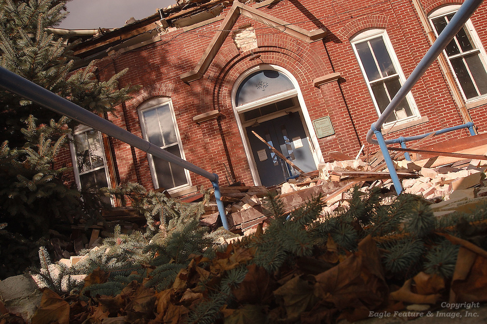 The main entry to the Holy Childhood school building is blocked by demolition rubble from the buildings upper floors.