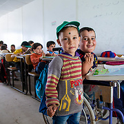 Khalid with his best friend, Soos, in their classroom. Zaatari camp for Syrian refugees, Jordan, April 2015.
