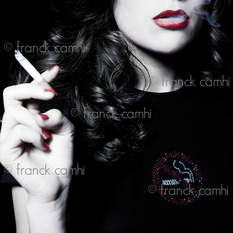 studio portrait of a beautiful woman on isolated on white background smoking addiction concept