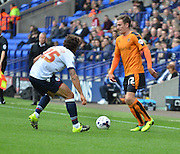 Jed Wallace looks for a way past Lawrie Wilson during the Sky Bet Championship match between Bolton Wanderers and Wolverhampton Wanderers at the Macron Stadium, Bolton, England on 12 September 2015. Photo by Mark Pollitt.