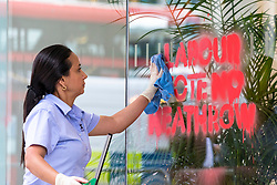 © Licensed to London News Pictures. 04/06/2018. London, UK. A cleaner removes graffiti urging Labour MPs to vote against the expansion of Heathrow Airport from outside the Labour Party headquarters in London. Photo credit: Rob Pinney/LNP