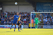 AFC Wimbledon defender Will Nightingale (5) winning header during the EFL Sky Bet League 1 match between AFC Wimbledon and Bristol Rovers at the Cherry Red Records Stadium, Kingston, England on 21 September 2019.