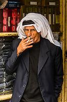 Jordanian man smoking cigarette, Amman, Jordan.