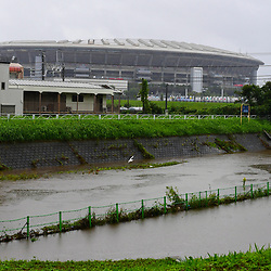 Heavy rain ahead of the arrival of Typhoon Hagibis, which led to the cancellationon of the France v England match, causes the river that runs past the stadium to burst its banks on on October 12, 2019 in Yokohama, Japan. (Photo by Dave Winter/Icon Sport) - --- - International Stadium Yokohama - Yokohama (Japon)