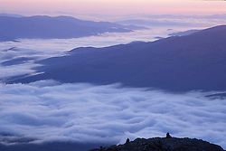 Fog in the valleys below Mt. Madison in New Hampshire's White Mountains. Sunrise.  Mt. Madison, NH