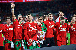 CARDIFF, WALES - Tuesday, October 13, 2015: Wales' Chris Gunter, Gareth Bale, Aaron Ramsey, Neil Taylor, Andy King celebrate qualifying for the finals after the 2-0 victory over Andorra during the UEFA Euro 2016 qualifying Group B match at the Cardiff City Stadium. (Pic by Barry Coombs/Propaganda)