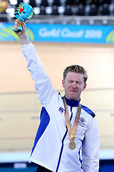 Scotland's Mark Stewart celebrates with the gold medal after winning the Men's 40km Points Race Final at the Anna Meares Velodrome during day four of the 2018 Commonwealth Games in the Gold Coast, Australia.
