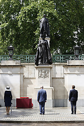 © Licensed to London News Pictures. 18/06/2020. London, UK. French President Emmanuel Macron, Prince Charles and Camilla, Duchess of Cornwall, arrive in The Mall for a ceremony at the statues of Queen Elizabeth, King George VI and General Charles de Gaulle. President Macron will later meet with Prime Minister Boris Johnson in Downing Street where they will watch a fly past by the Red Arrows and the Patrouille de France (PAF), the aerobatics demonstration team of the French Air Force. Today's events commemorate the 80th anniversary of the Second World War resistance leader General Charles de Gaulle's historic broadcast to occupied France on June 18, 1940. Photo credit: Peter Macdiarmid/LNP