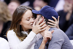 61092156<br /> Olivia Wilde and Jason Sudeikis are seen kissing each others at the Staples Center, Los Angeles, USA, during a Los Angeles Clippers game, Tuesday, 18th February 2014. Picture by  imago / i-Images<br /> UK ONLY