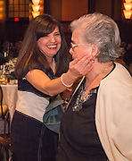Aleida Rios hugs her mother after receiving a distinguished alumni award during the State of the Schools luncheon at the Hilton of the Americas, February 15, 2017.