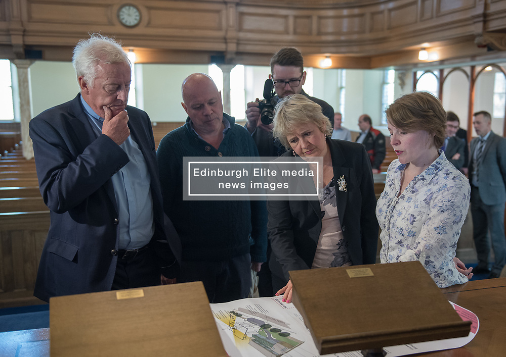 Environment Secretary, Roseanna Cunningham MSP, was in Portobello today to meet the Action Porty community right-to-buy group to mark the Scottish Government giving consent to proceed with the first community right to buy in an urban area. Pictured: Rev Dr George Whyte, Church Commissioners, Justin Kenrick, Roseanna Cunningham MSP, Kyrsta Macdonald-Scott<br /> <br /> © Jon Davey/ EEm