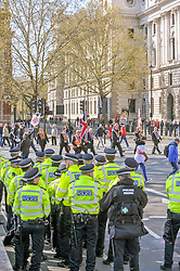 Police look on as Orange men of the Orange order march through Parliament Square towards Whitehall to lay wreaths at the Cenotaph London.<br /> <br /> Richard Hancox | EEm 13042019