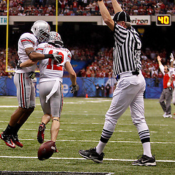 January 4, 2011; New Orleans, LA, USA; Ohio State Buckeyes wide receiver Corey Brown (10) celebrates with wide receiver Dane Sanzenbacher (12) following a touchdown against the Arkansas Razorbacks during the second quarter of the 2011 Sugar Bowl at the Louisiana Superdome.  Mandatory Credit: Derick E. Hingle