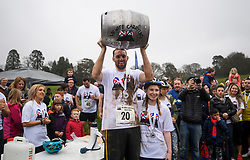 **CAPTION CORRECTION ON SPELLING OF WINNERS NAME**<br /> © Licensed to London News Pictures. 08/04/2018. Dorking, UK. Winners of the race CHRIS HEPWORTH AND TANISHA PRINCE  are presented with a barrel of beer. Competitors take part in the 2018 annual Wife Carrying Race in Dorking, Surrey. The race, which is run over a course of 380m, with both men and women carry a 'wife' over obstacles, is believed to have originated in the UK over twelve centuries ago when Viking raiders rampaged into the northeast coast of England carrying off any unwilling local women . Photo credit: Ben Cawthra/LNP