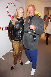 CLARA FISCHER and actor STEVEN BERKOFF at the annual Sotheby's Summer Party held at their auction rooms 34-35 New Bond Street, London W1 on 19th June 2008.<br />