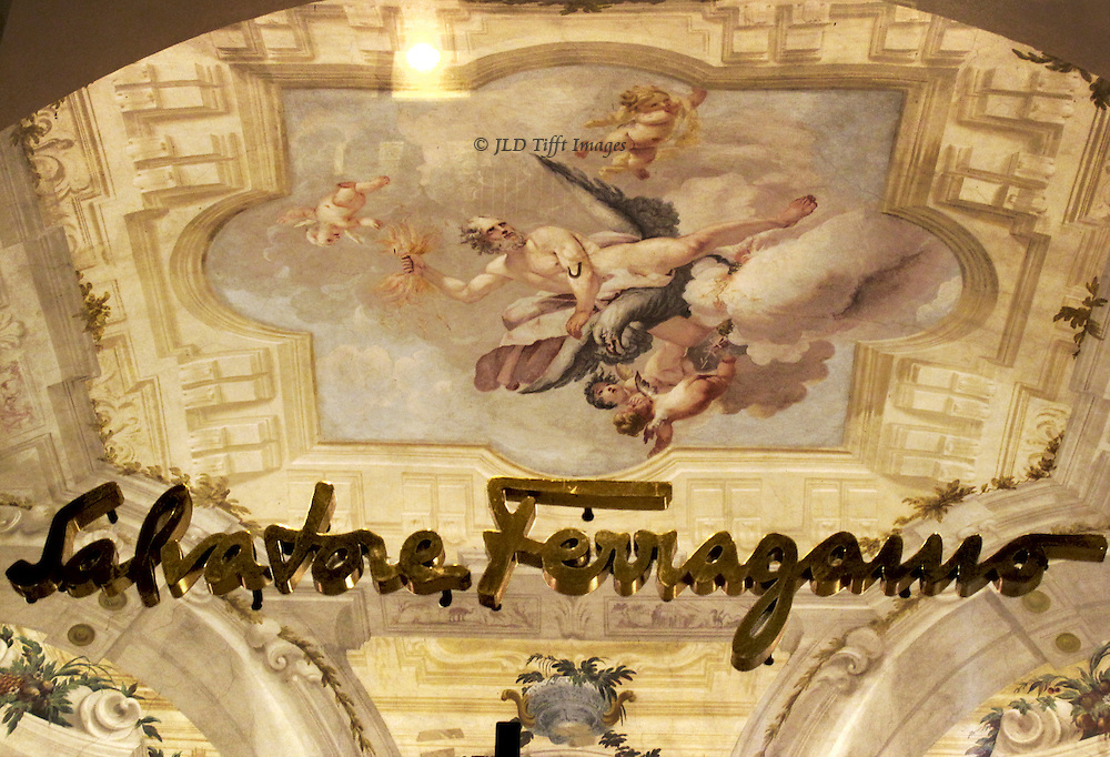 Ferragamo has the splendid medieval Palazzo Spini Feroni for the company museum.  A look through the window shows the painted plaster ceiling with an image of a male figure astride a flying eagle, surrounded by cherubs.