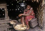 Africa, Democratic Republic of the Congo, Ngiri River area, Libinza tribe. Girl preparing manioc.