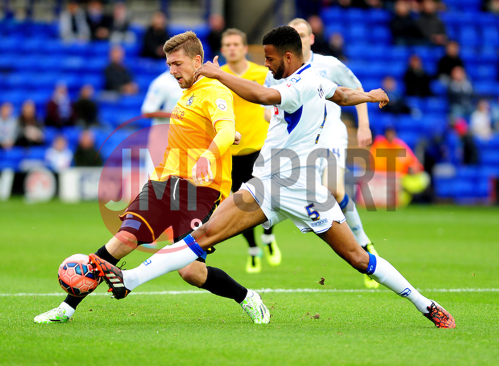 Bristol Rovers' Ryan Brunt is challenged by Tranmere Rovers's Michael Ihiekwe - Photo mandatory by-line: Neil Brookman/JMP - Mobile: 07966 386802 - 08/11/2014 - SPORT - Football - Birkenhead - Prenton Park - Tranmere Rovers v Bristol Rovers - FA Cup - Round One