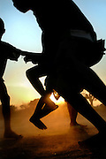 Benin, Natitingou November 26, 2006 - Sunlight Silhouetting Beninese Boys