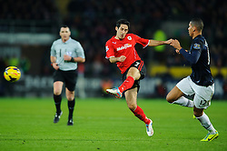 Cardiff Midfielder Peter Whittingham (ENG) is challenged by Man Utd Defender Chris Smalling (ENG) during the second half of the match - Photo mandatory by-line: Rogan Thomson/JMP - Tel: Mobile: 07966 386802 - 24/11/2013 - SPORT - FOOTBALL - Cardiff City Stadium - Cardiff City v Manchester United - Barclays Premier League.