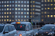 A taxi queues in heavy traffic on London Bridge during the evening rush-hour, on 7th November 2018, in London, England.