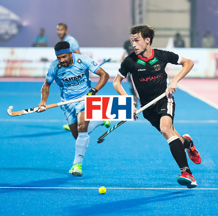 BHUBANESWAR - Hockey World League finals Match for bronze , Germany v India (1-2). Florian Fuchs (Ger) with Birendra Lakra (Ind) COPYRIGHT KOEN SUYK