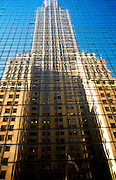 USA NEW YORK CITY NOV97 - The Chrysler Building is reflected in glass panels of the building opposite along 42nd Street. Photography by Jiri Rezac<br />
