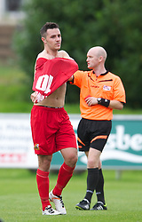 LLANELLI, WALES - Saturday, September 15, 2012: Llanelli's Luke Bowen takes off his shirt after being shown the red card and sent off by referee A.P. Harms during his side's 3-0 defeat by Newtown during the Welsh Premier League match at Stebonheath Park. (Pic by David Rawcliffe/Propaganda)