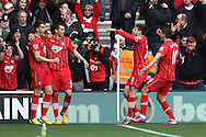 Picture by Daniel Chesterton/Focus Images Ltd +44 7966 018899.16/03/2013.Morgan Schneiderlin of Southampton (left) celebrates scoring his side's first goal during the Barclays Premier League match at the St Mary's Stadium, Southampton.