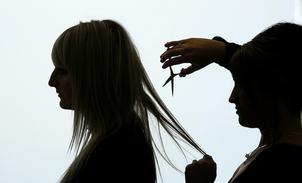 A hairdresser using sissors to cut a clients hair, New Plymouth, New Zealand, July 09, 2007. Credit:SNPA / Rob Tucker