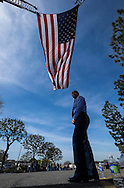 A member of Los Angeles Fire Department stands beneath a giant U.S. flag over the processional route during the funeral of Whittier Police Officer Keith Boyer at Rose Hills Memorial Park in Whittier, Calif., Friday March 3, 2017. Boyer, who was fatally shot after responding to a traffic crash, was remembered today by thousands of law enforcement officers, friends and family as a dedicated public servant, talented drummer, loving friend and even a ``goofy'' dad.(Photo by Ringo Chiu/PHOTOFORMULA.com)<br />