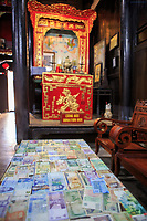 The money of various nations on display in Quan Thang House in the old town of Hoi An, Vietnam