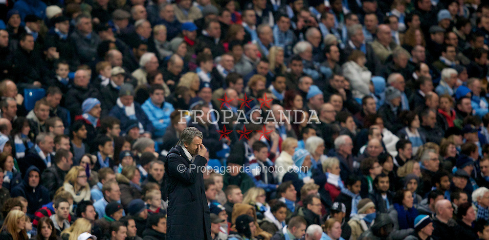 MANCHESTER, ENGLAND - Thursday, March 15, 2012: Manchester City's manager Roberto Mancini looks dejected during the UEFA Europa League Round of 16 2nd Leg match against Sporting Clube de Portugal at City of Manchester Stadium. (Pic by Vegard Grott/Propaganda)