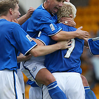 St Johnstone v Brechin City....30.08.03<br />St Johnstones John Robertson  and Darren Dods mob Mixu Paatelainen after his goal<br /><br />Picture by Graeme Hart<br />Perthshire Picture Agency<br />Tel: 01738 623350 / 07990 594431
