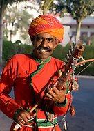 A man playing a musical instrument in Jaipur, Rajasthan, India