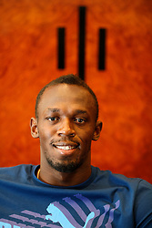 UK ENGLAND LONDON 28JUL13 - Jamaican sprinter Usain Bolt reacts during an interview at the Tower Hotel in London, England.<br />