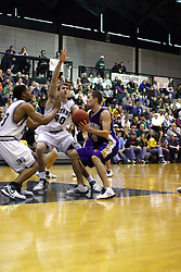 30 December 2006: D.J.Mocini is stopped on his approach by Darius Gant and Brett Chamernik. The Titans outscored the Britons by a score of 94-80. The Britons of Albion College visited the Illinois Wesleyan Titans at the Shirk Center in Bloomington Illinois.<br />