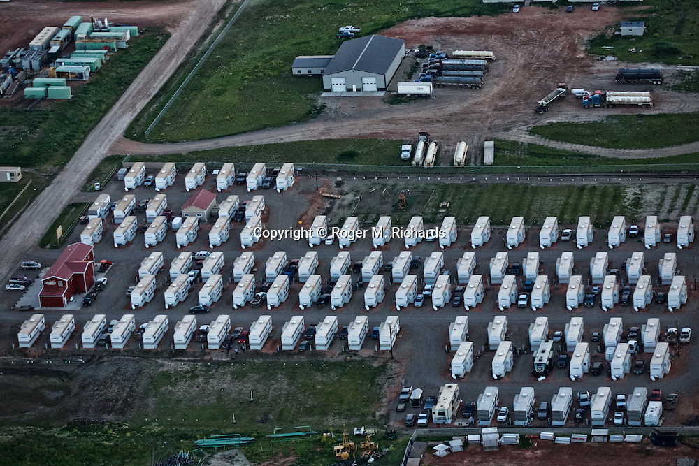 A temporary housing area for oil workers, dubbed a 'man camp', viewed from the air. The Bakken Shale formation in North Dakota contains some of the richest deposits of oil and gas in the world. This has led to a boom in hydraulic fracturing (fracking) in the state and region, with considerable economic benefits but also negative consequences for residents way of life and environment of the area.