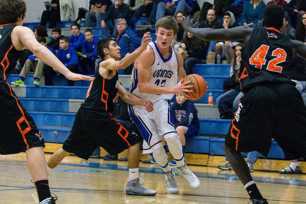 GABE GREEN/Press<br /> <br /> Devin Kluss, a forward for Coeur d&rsquo;Alene, takes the ball down the court Saturday, pushing his way through Kennewick players.